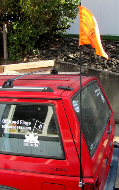 High Visibility orange flag on Jeep Cherokee